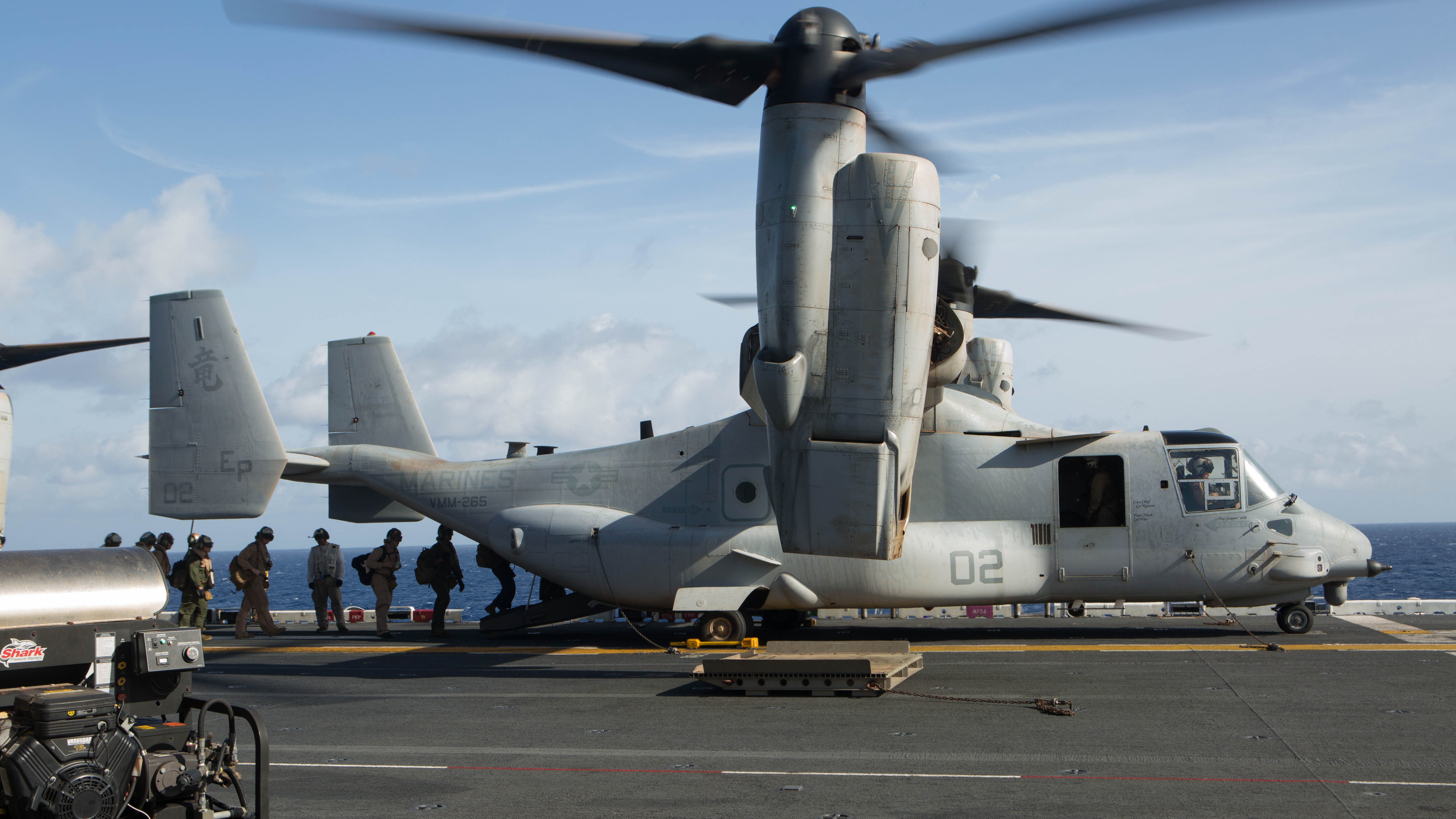 U.S. Marines and sailors with the 31st Marine Expeditionary Unit load into an MV-22B Osprey aboard the USS Bonhomme Richard (LHD 6), Aug. 8, 2015. The 31st MEU is staging Ospreys in Guam in support of typhoon recovery efforts in Saipan. The aircraft will be on standby in the event their aerial lift capacity is needed to distribute emergency supplies to remote areas. Saipan, the most populated island in the Commonwealth of the Northern Mariana Islands, was struck by Typhoon Soudelor Aug. 2-3. (U.S. Marine Corps photo by Cpl. Tyler Ngiraswei/ Released)