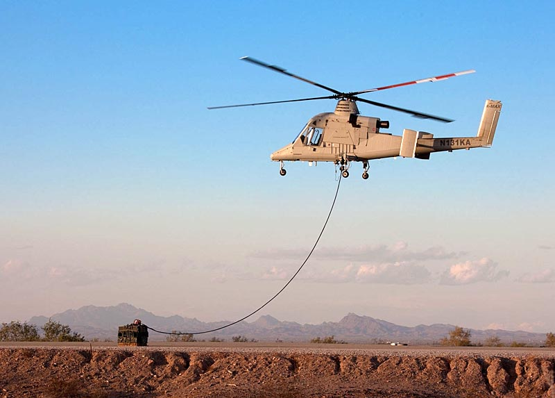 CREDIT: Lockheed Martin An unmanned K-MAX helicopter takes off with a 1,500-pound sling load during contractor flight testsÊin January at Yuma Proving Ground,ÊAriz.